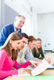 College students learning with professor stock photography