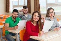 College Students In Lecture Room At High School. Young Group Of Attractive Teenage Students In A College Classroom Sitting At A Table - Learning Lessons Royalty Free Stock Photography