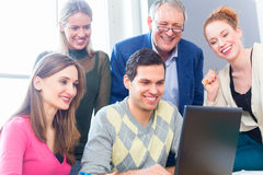 College students lerning with professor Royalty Free Stock Images