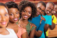 College students line up. Group of cute african college students line up stock photography