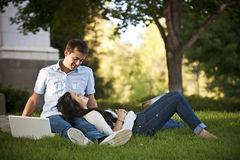 College Students in Love. A young couple enjoying spending time together while studying on campus Royalty Free Stock Photos