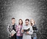 College students near blackboard Stock Photo