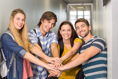 College students placing hands together Stock Image