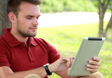 College students playing tablet Royalty Free Stock Photography