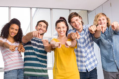 College students pointing at camera Royalty Free Stock Images