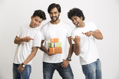 College students posing with gift boxes stock photo