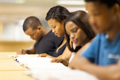 College students reading. Group of african college students reading in library Royalty Free Stock Images