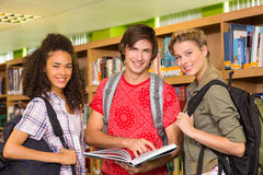 College students reading book in library Stock Image