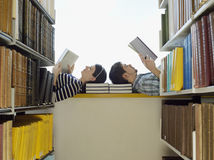 College Students Reading In Library Royalty Free Stock Image