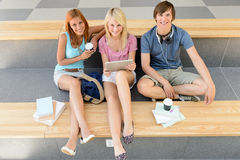 College students relax during break with tablet Royalty Free Stock Images