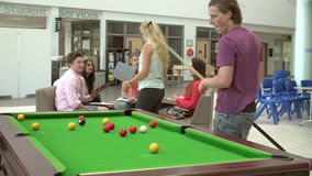 College Students Relaxing And Playing Pool Together stock footage