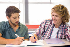 College students sitting in classroom Royalty Free Stock Image