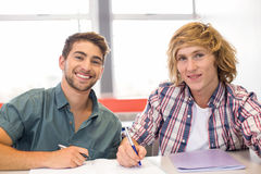 College students sitting in classroom Royalty Free Stock Photos