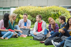 College students sitting in the park Royalty Free Stock Photography