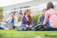 College students sitting in the park Stock Photo