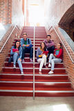 College students sitting on stairs in the college Stock Photos