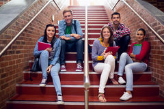 College students sitting on stairs in the college Royalty Free Stock Image