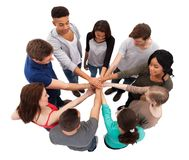 College students stacking hands Stock Image