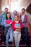 College students standing on stairs in college Royalty Free Stock Photography