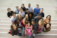 College Students On Steps. High angle portrait of multiethnic college students on steps Royalty Free Stock Image