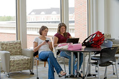 College Students Studying. Two College Students Studying Together Stock Photo
