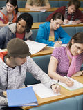 College Students Studying In Class stock image