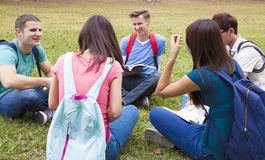 College students studying and discuss together in campus Stock Photography