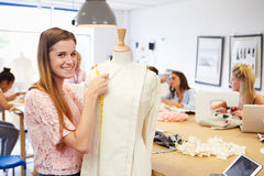 College Students Studying Fashion And Design Stock Photo
