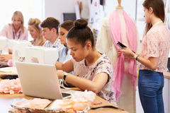College Students Studying Fashion And Design Stock Image
