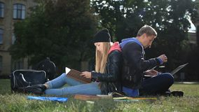 College students studying near campus stock footage