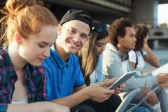 College students studying outdoor, preparing for exams royalty free stock image