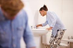 College Students Studying Plumbing Working On Washbasin Stock Photo