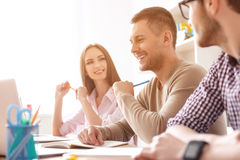 College students studying together at home. What did you think of that lecture. Smiling group of college students sitting together and studying Stock Photography
