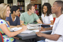 College students studying together in a library Stock Images