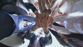College Students Teamwork Stacking Hand Concept. Friendly graduates of the senior school put their hands on each other stock video