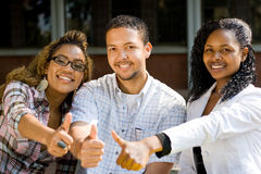 College students thumbs up Royalty Free Stock Photography