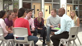 College Students With Tutor Having Discussion stock footage