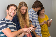 College students using cellphones Royalty Free Stock Photography