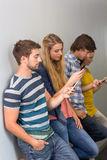 College students using cellphones Stock Photos