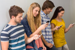 College students using cellphones Stock Images