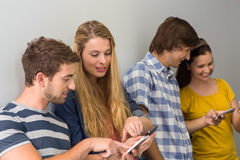 College students using cellphones Royalty Free Stock Photo