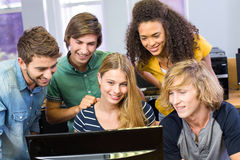 College students using computer Royalty Free Stock Image