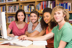 College students using computer in library Stock Photo
