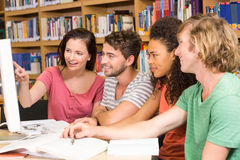 College students using computer in library Stock Photos