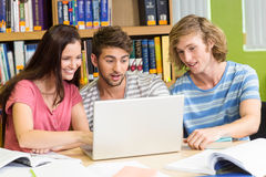College students using laptop in library Royalty Free Stock Image