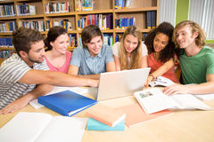 College students using laptop in library Stock Image