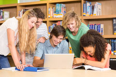 College students using laptop in library Stock Photography