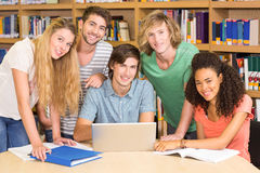 College students using laptop in library Royalty Free Stock Photography