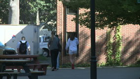 College students walking on campus. A view or scene from around town stock footage
