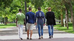 College of students walking together on campus stock video
